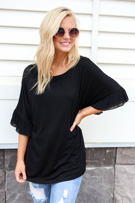 Model wearing Black Ruffle Sleeve Tee