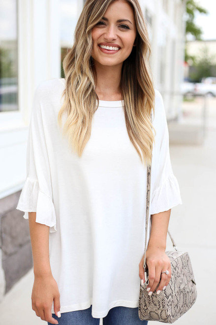 Model wearing White Ruffle Sleeve Tee