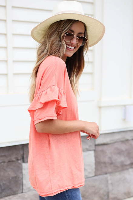 Model wearing Coral Ruffle Sleeve Top Side View