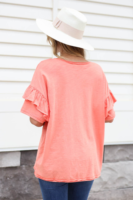 Model wearing Coral Ruffle Sleeve Top Back View