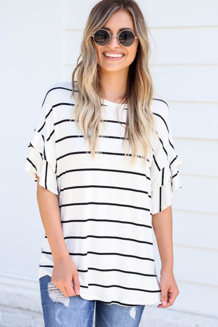 Model wearing White and Black Striped Ruffle Sleeve Top Front View