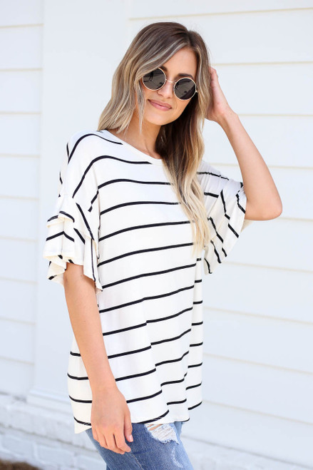 Model wearing White and Black Striped Ruffle Sleeve Top Side View