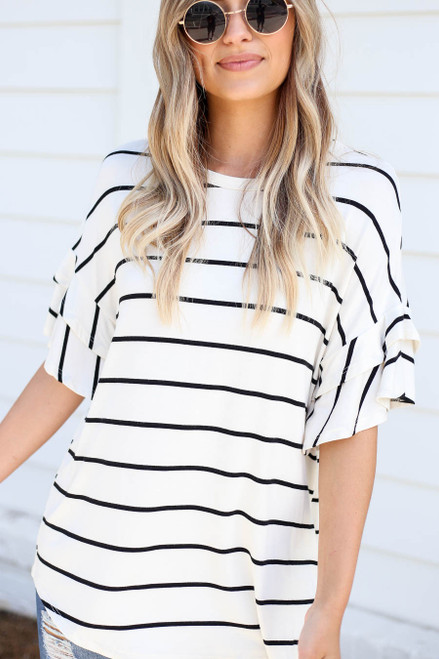 Model wearing White and Black Striped Ruffle Sleeve Top Detail View