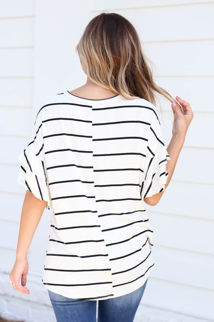 Model wearing White and Black Striped Ruffle Sleeve Top Back View