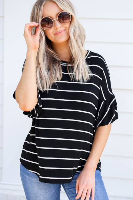 Model wearing Black and White Striped Ruffle Sleeve Top Front View