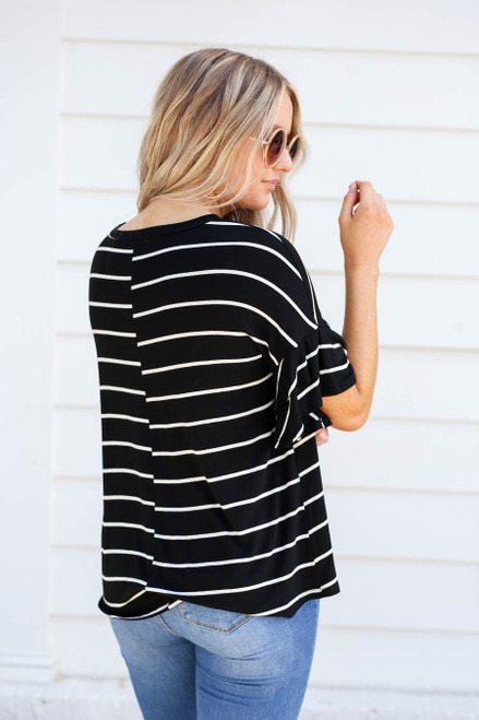 Model wearing Black and White Striped Ruffle Sleeve Top Back View