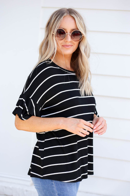 Model wearing Black and White Striped Ruffle Sleeve Top Side View