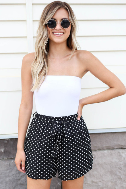Model wearing Black and White Polka Dot Tie-Waist Shorts Front View