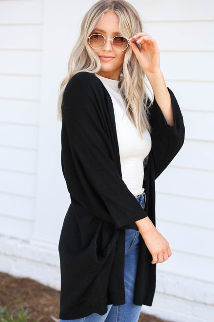 Model wearing Black Wide Sleeve Pocketed Cardigan Side View