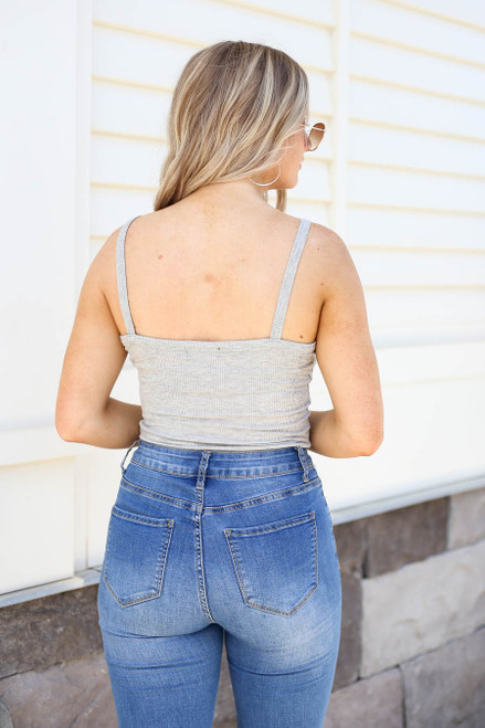 Model wearing Heather Grey Ribbed Button Up Bodysuit Back View
