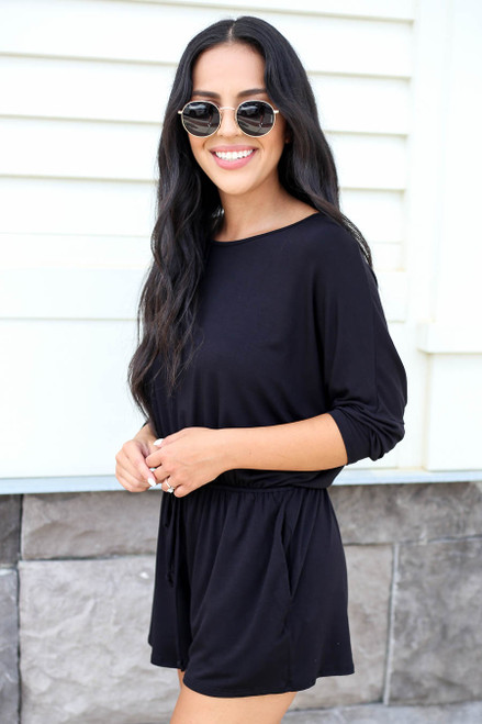 Model wearing Black 3/4 Sleeve Soft Knit Casual Romper Side View