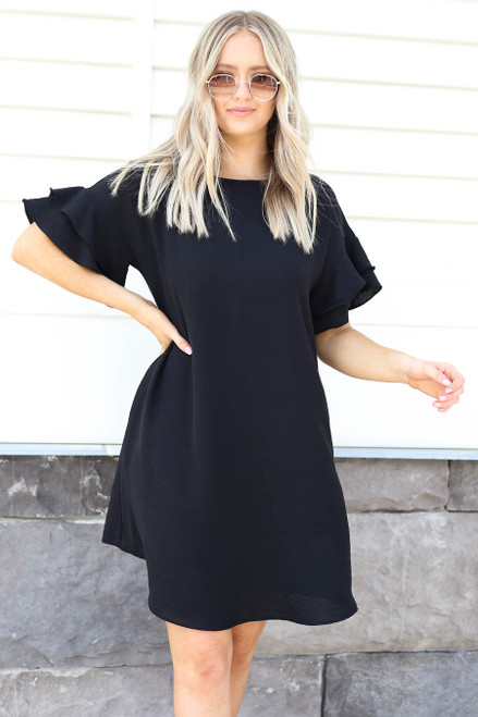 Model wearing Black Ruffle Sleeve Mini Dress Front View