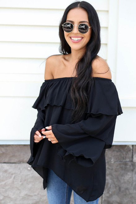 Model wearing Black Off the Shoulder Ruffled Sleeve Tiered Top