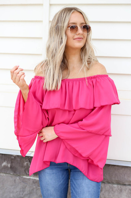 Model wearing Fuchsia Off the Shoulder Ruffled Sleeve Tiered Top