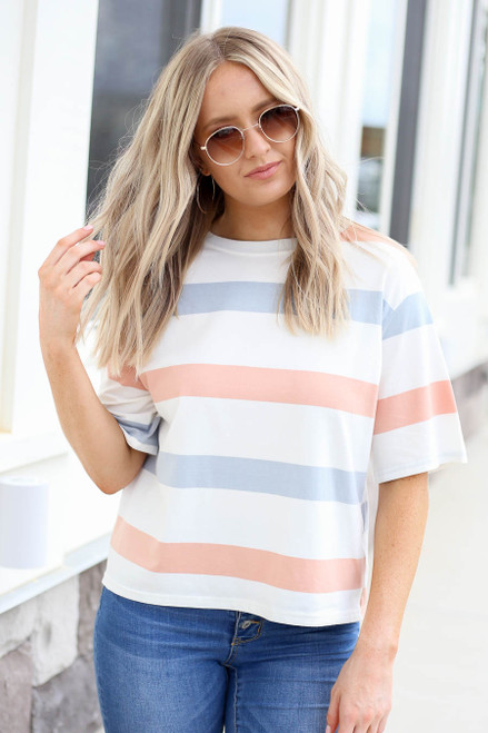 Model wearing Peach , White and Light Blue Striped Cropped Tee