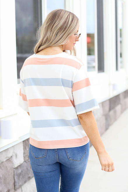Model wearing Peach , White and Light Blue Striped Cropped Tee Back View