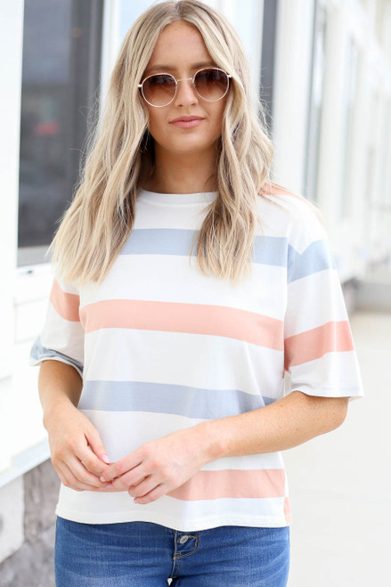 Model wearing Peach , White and Light Blue Striped Cropped Tee Front View