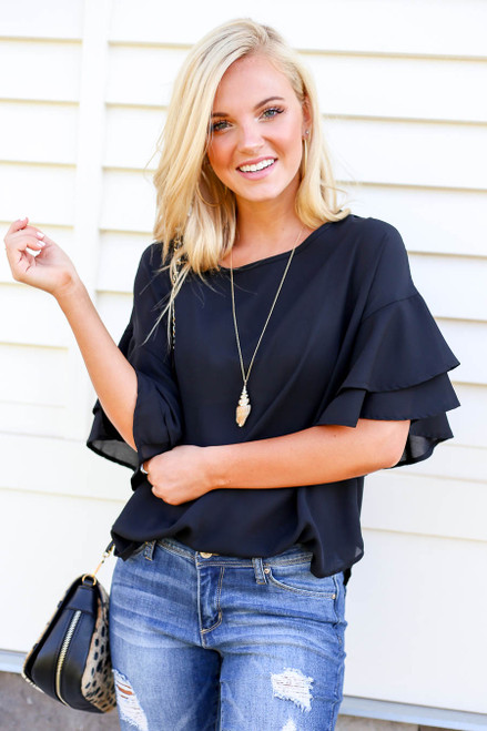Model wearing Black Ruffle Sleeve Blouse Front View