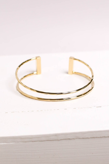 Flat Lay of Gold Hammered Cuff Bracelet