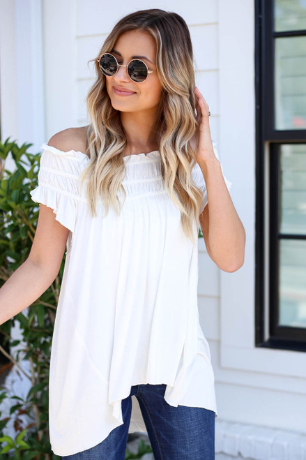 Model wearing White Off the Shoulder Ruched Top