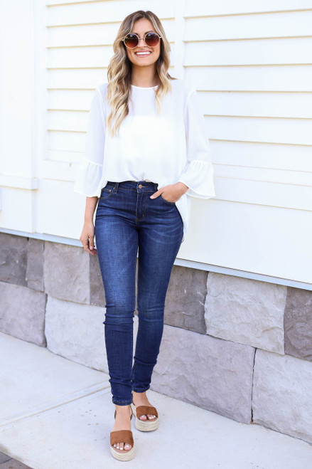 Model wearing Dark Wash Skinny Jeans