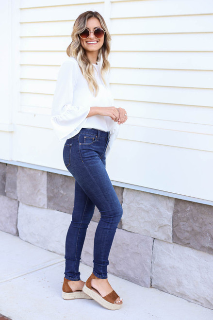 Model wearing Dark Wash Skinny Jeans Side View