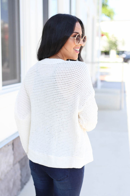 Model wearing Ivory Button Front Lightweight Waffle Knit Cardigan Back View