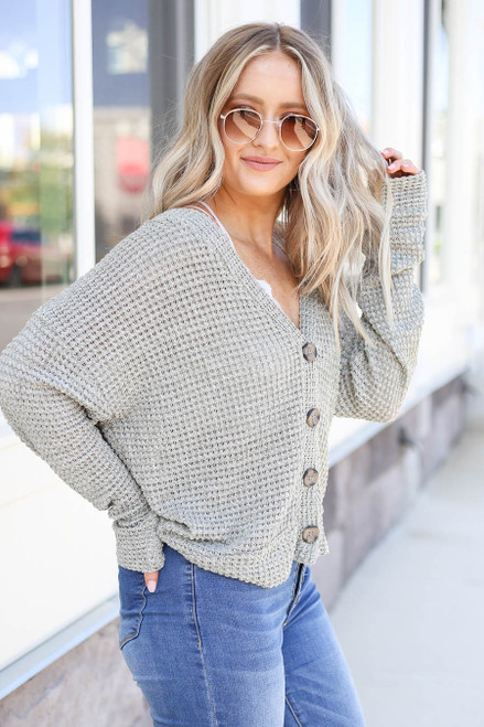 Model wearing Olive Button Front Lightweight Waffle Knit Cardigan Side View