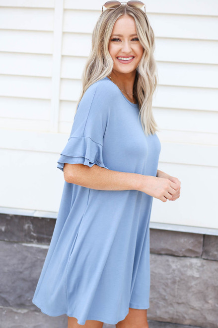 Model wearing Blue Tiered Sleeve T-Shirt Dress Side View