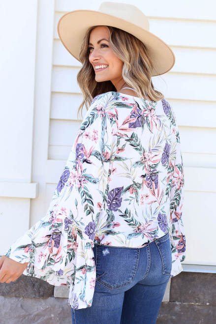 Model wearing White Floral Bell Sleeve Tie-Front Blouse Back View