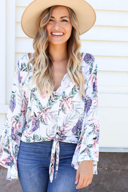 Model wearing White Floral Bell Sleeve Tie-Front Blouse Front View