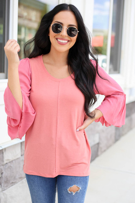 Model wearing Coral Contrast Sleeve Top