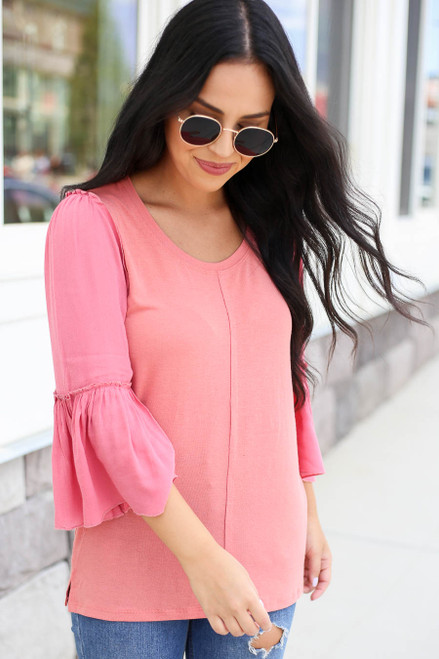 Model wearing Coral Contrast Sleeve Top Side View