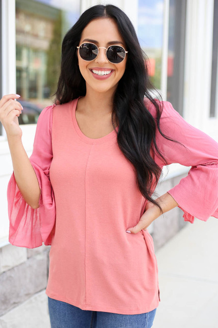 Model wearing Coral Contrast Sleeve Top Front View