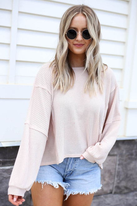 Model wearing Taupe Draped Open Back Sweater Front View