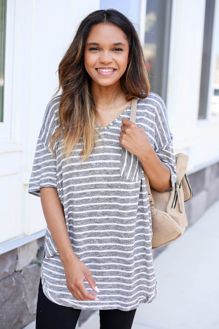 Model wearing Black and White Striped Short Sleeve Knit Tee Side View