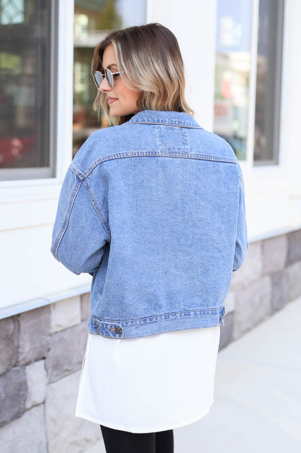 Model wearing Medium Wash Vintage Fit Denim Jacket Back View