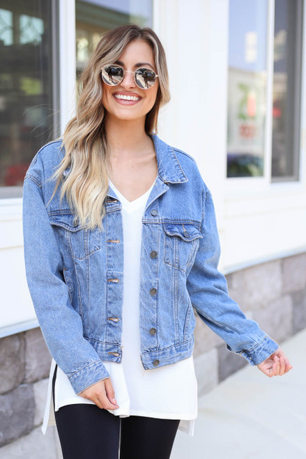 Model wearing Medium Wash Vintage Fit Denim Jacket