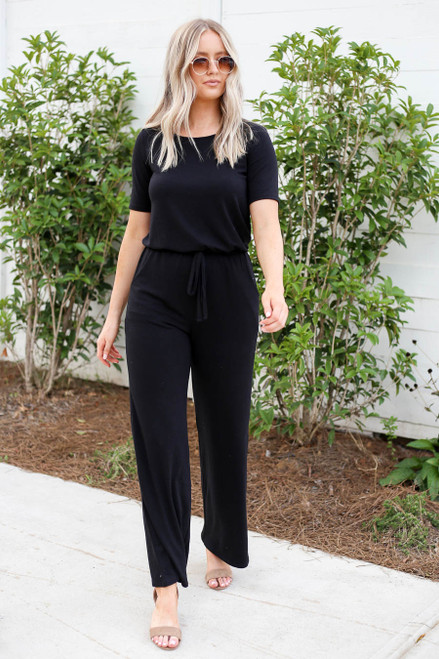 Model wearing Black Soft Knit Short Sleeve Jumpsuit Front View