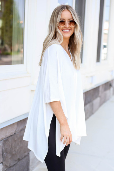 Model wearing White V-Neck Oversized Poncho Top Side View