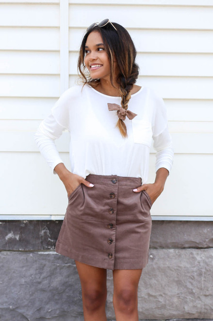 Model wearing Taupe Corduroy Button Front Mini Skirt