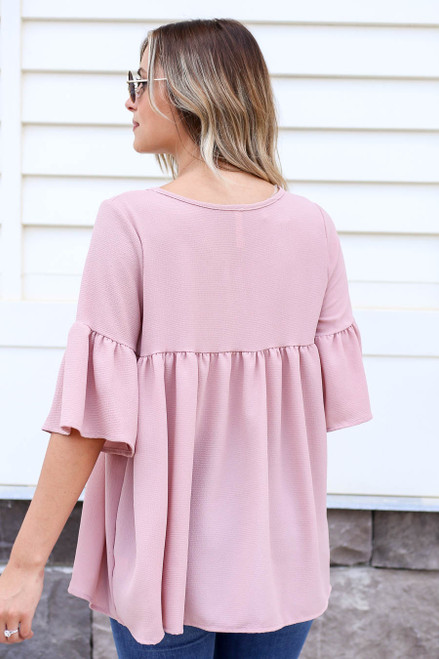 Model wearing Blush Babydoll Bell Sleeve Blouse Back View