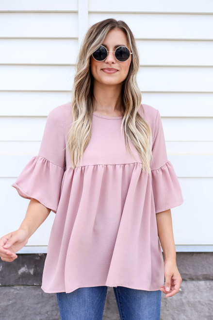 Model wearing Blush Babydoll Bell Sleeve Blouse