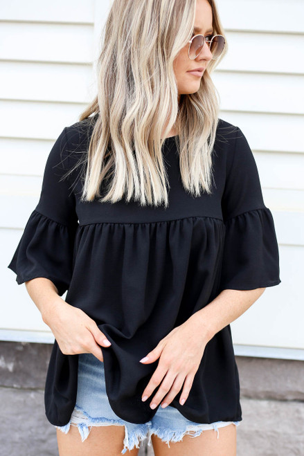 Model wearing Black Babydoll Bell Sleeve Blouse