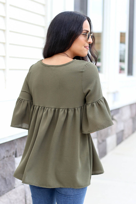 Model wearing Olive Babydoll Bell Sleeve Blouse Back View