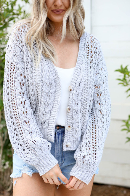 Model wearing Grey Cropped Cable Knit Cardigan Detail View