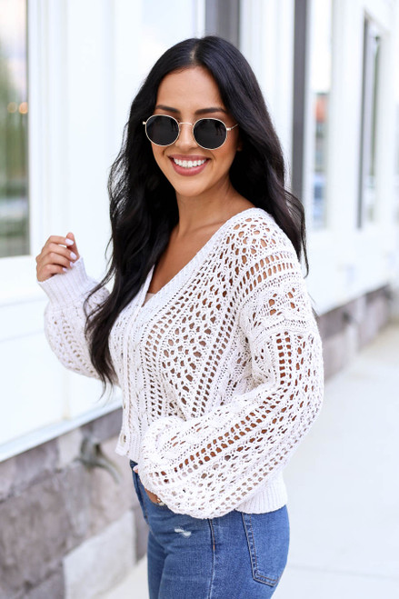 Model wearing Taupe Cropped Cable Knit Cardigan Side View