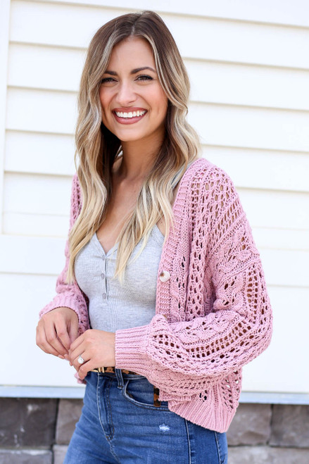 Model wearing Blush Cropped Cable Knit Cardigan