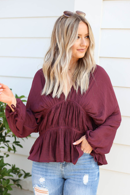 Model wearing Burgundy Long Sleeve Ruched Blouse