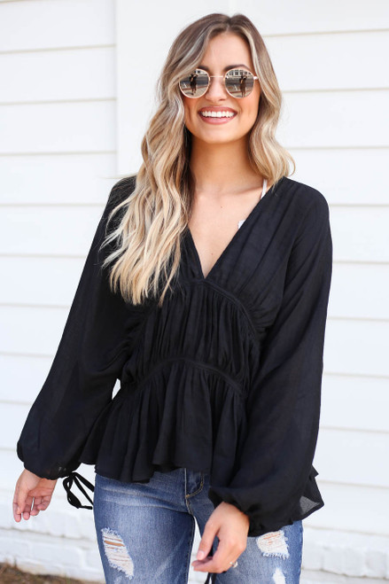 Model wearing Black Long Sleeve Ruched Blouse